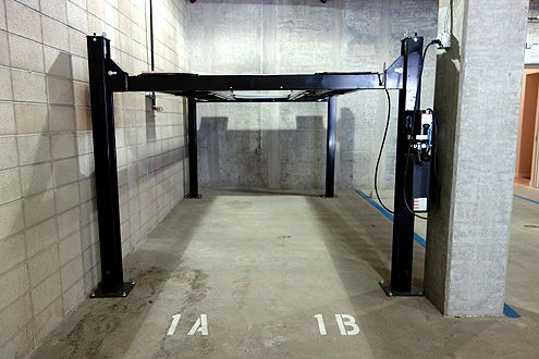 Some parking spaces will have hydraulic lifts to fit two cars in one space