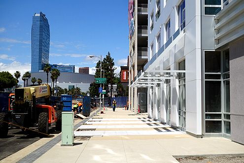 Brand new wide sidewalks with street fronting retail spaces will help revitalize and activate this stretch of Figueroa south of Pico