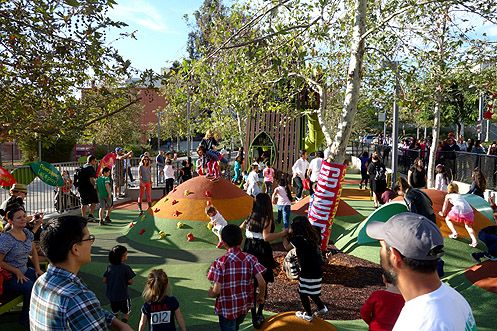 Children jump, climb, and slide in the new Grand Park Playground