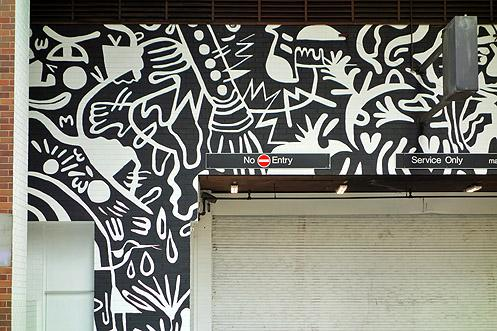 Sumi Ink Club's black and white mural forms a cheerful expression of various abstract images