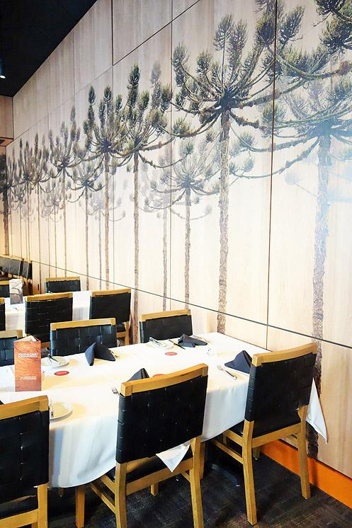 Brazilian Araucaria trees adorn the walls of the restaurant