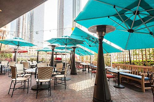 Dine under gleaming skyscrapers in the sprawling outdoor patio facing Grand Ave (Photo: Wonho Frank Lee | Eater LA)