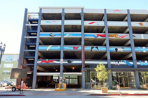 A new fanciful mural by artist duo devNgosha has given new life to a once drab parking structure