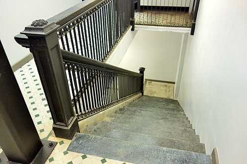 Original stairwell banisters and floors