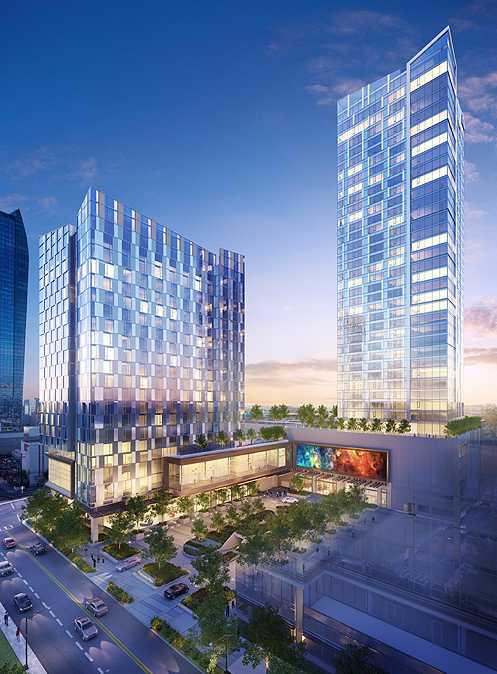 Phase I includes the 19-story boutique hotel (left) and the 38-story residential tower with 310 luxury condos