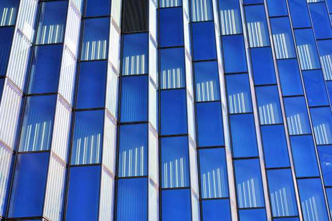 A closer look at the 1,672 zigzag blue glass panels that will help control sunlight penetration into the building to increase energy efficiency