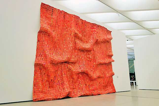 El Anatsui's Red Block (2010) found aluminum and copper tapestry