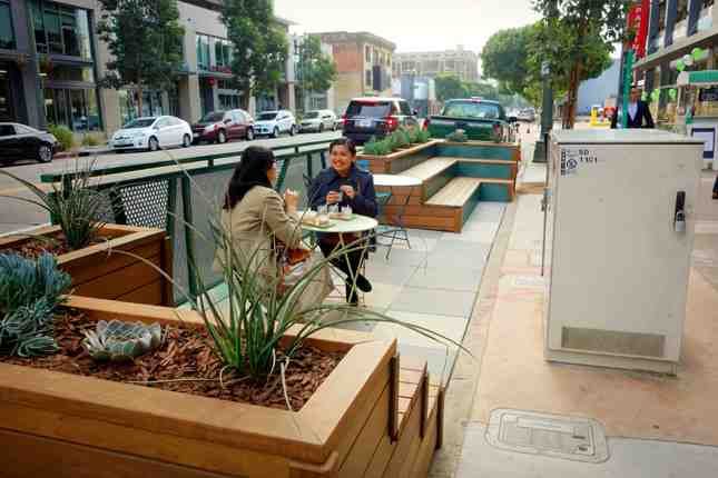 The new parklet encourages you to linger a bit and enjoy the city