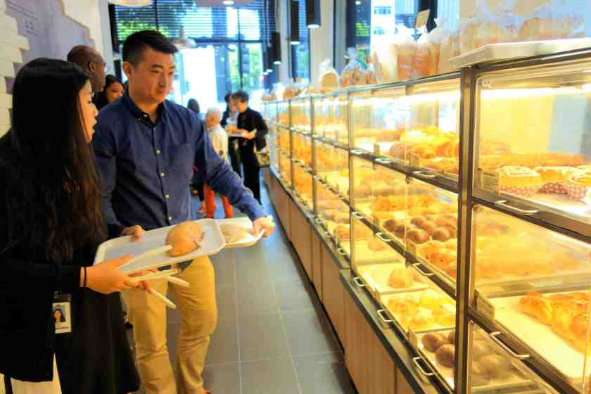 A wide variety of sweet and savory pastries line the wall