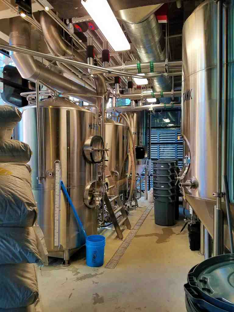 The large onsite brewing vats are displayed proudly for customers to see