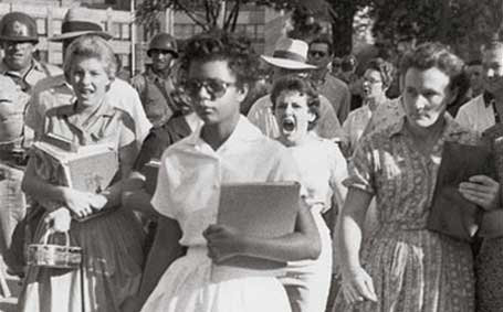 A photograph taken by Will Counts of Elizabeth Eckford attempting to enter Little Rock School on 4th September, 1957. The girl shouting is Hazel Massery.