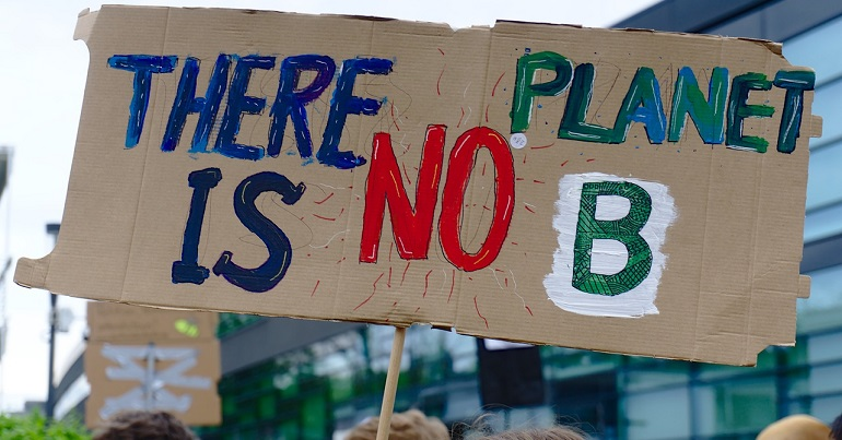 "Climate protest placard reading: ""There is no planet B"""