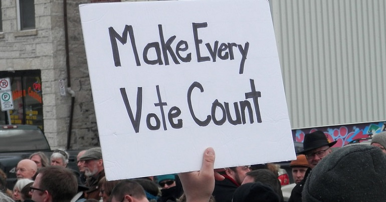 "Placard reading ""Make every vote count"""