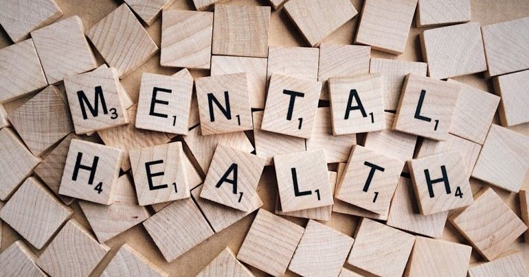 "Scrabble letters reading ""mental health"""