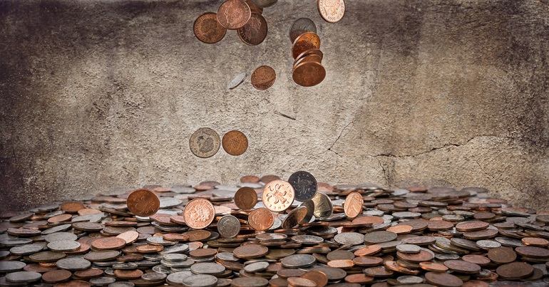 Coins falling into a larger pile of coins