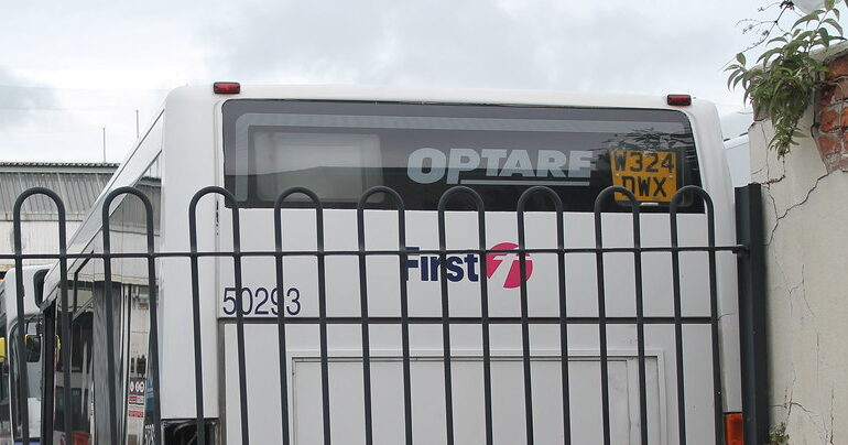 Optare made bus, behind a fence