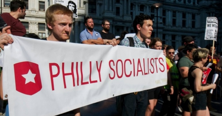 "A group of people with a banner reading ""Philly Socialists"""