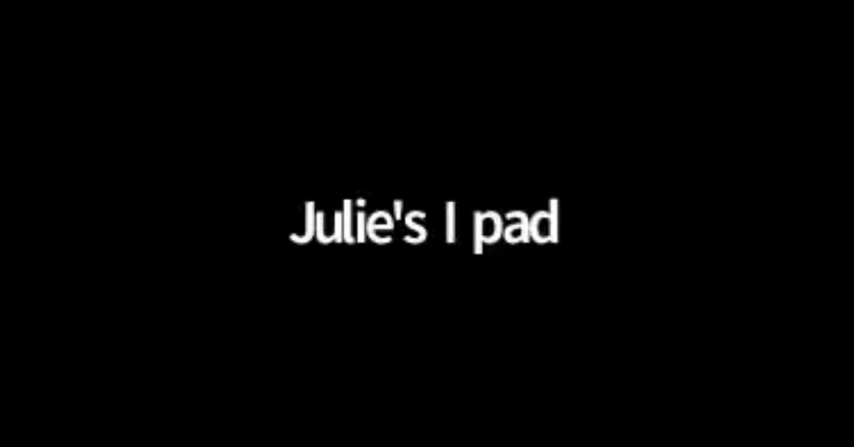 """A black screen reading with text reading """"Julie's I pad"""", taken from a Handforth Parish Council online meeting"""