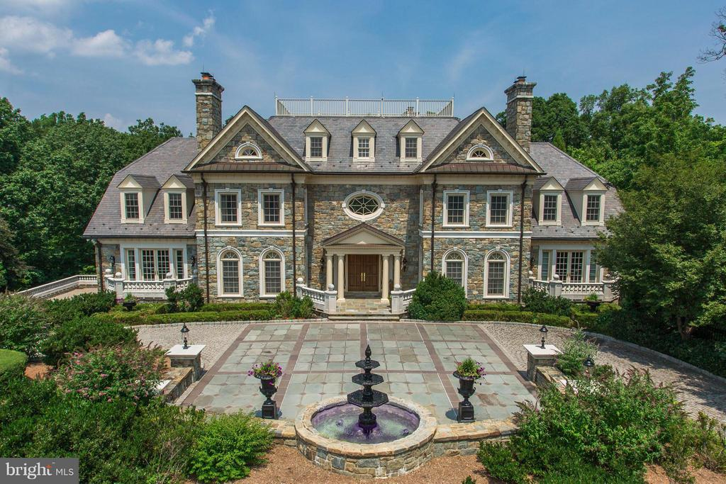 Exquisite Georgian Manor on 5+ acres with 16,000 sq ft of living space in a gated sanctuary.  Constructed with precision craftsmanship and attention to every last detail. 7 bedrooms, including basement BR with kitchen for live-in help, 8 full and 2 half baths & 8 fireplaces.  This modern castle features a pool, hot tub, card room, wine cellar, theater with seating for 10, and more. Impeccable!