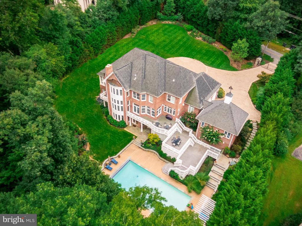 OPEN HOUSE SAT, 4/20, 12 - 2pm. Minutes from Tysons Corner, Metro, Dulles Airport, Commuter Routes & McLean Shopping, Dining and Entertainment. Private, Gated, Luxury Estate on 2.4 Acres. Gated Access, Luxury Lighted, Stone Circular Drive with 4 Car Garage. Extensive Hardscape, Exterior Lighting, Landscaping Front and Back, Fully Fenced. Multi-Level Decking, Stone Patios and Walkways, Large Pool and Cabana, Pergolas, Backs to Woods. All Brick, Custom Estate Home Extensively Expanded and Renovated Throughout. Exquisitely Appointed with Luxury Updates and Open Floorplan for Gracious Living Inside and Out. Spectacular Foyer Entry Flanked by Formal Living and Dining Rooms, Grand Solarium and Private Office with Balcony. Spacious Gourmet Kitchen with Professional Viking, Boche, SubZero Appliances Adjoins Sunny Breakfast Room with Deck Access. Soaring Family Room with Grand Curved Floor To Ceiling Windows and Raised Stone Hearth. Upper Level Gallery Accessed by Front and Back Stairways with Grand Master Suite and 4 Additional En Suite Bedrooms. Huge Walk In Attic/Storage Room. Fantastic Lower Level with Large Family Room with Raised Wood Burning Stone Hearth and Coffered Ceiling, Full Loaded Wet Bar, Game Room, Gym and 2 Additonal Bedrooms and Full Bathrooms (Perfect In Law  or Au Pair Suite). Dual French Doors Walk Out to Extensive Patio / Pool / Cabana Area. 20x40 Heated Pool, Hot Tub, Cabana / Pool House. Beautifully Landscaped, Lighted Grounds. Spectacular Secluded Great Falls Address with McLean Convenience! Just 3.4 Miles to Tysons Corner & Metros. The One!