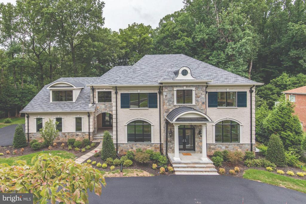 THIS IS A DEAL OF A LIFETIME! MOTIVATED BUILDER HAS REDUCED THE SALES BEST VALUE IN MCLEAN, $345 Per Sq. Foot, PRICE Dropped $245,000 SINCE ORIGINAL LIST PRICE. INVESTORS WELCOME! OPEN EVERY SUNDAY 1-4 PMBeautiful Middleburg Associates Custom Home is Langley Forest on a Wooded, Walk Out 1 acre Lot. It has hardwood on all levels, 3 Gas Fireplaces (2 stone), A master suite to die for with Custom  Designer Closets, All bedrooms have their own suite, Fully finished Walk out Basement with a ton of light, Bar and Wine Room. So much more, call agent for a tour.