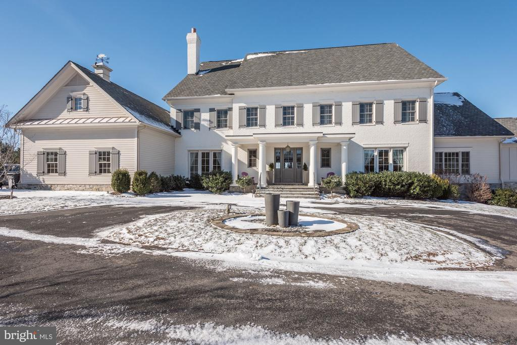 Elegant custom-built 11,000+ square foot home in lovely Creighton Farms.  Double sized lot located on the 16th hole with panoramic views.  House includes first floor master suite, gourmet kitchen, sunroom and private indoor pool.  Wide plank floors, high ceilings and custom architectural detail add to the beauty of this home.  Security gate gives added peace of mind.