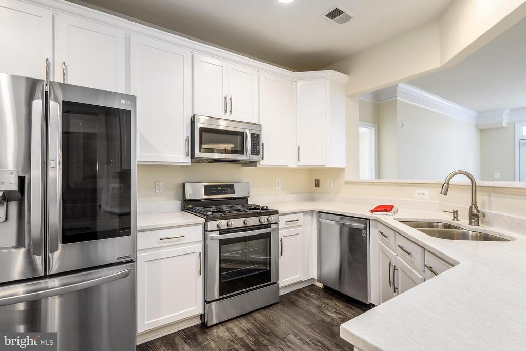 Seller has dropped price $30,000.  Now priced $110,000 less than Atrium.- Vienna Metro location, rare opportunity with PENTHOUSE corner unit in the Main Building (Club & Fitness Rooms are in the main building).  1,264 Square Feet not including balcony terrace. Age 55+ Bldg. Beautifully renovated LIGHT-FILLED unit with Gourmet Kitchen, NEW Quartz Counters, NEW Solid Wood Kitchen Cabinetry, NEW high end carpeting, NEW LG Stainless Steel Appliances, NEW engineered wood floors. Moen Kitchen faucet. Luxurious Master Bathroom, both soaking tub and shower stall.  Split BR open floor plan with generous separate LR & DR. 9+ feet Ceilings; Private STORAGE Room #37 (300sf) in bldg.  Sprinkler system in every room. Full-time Concierge.  Double-wide Balcony terrace (22ft) with magnificent views.  3 Elevator banks.  Home warranty.  Tremendous advantage of living on the top floor because there is no noise factor above, plus the long distance views.  Eastern and Northern light exposure.