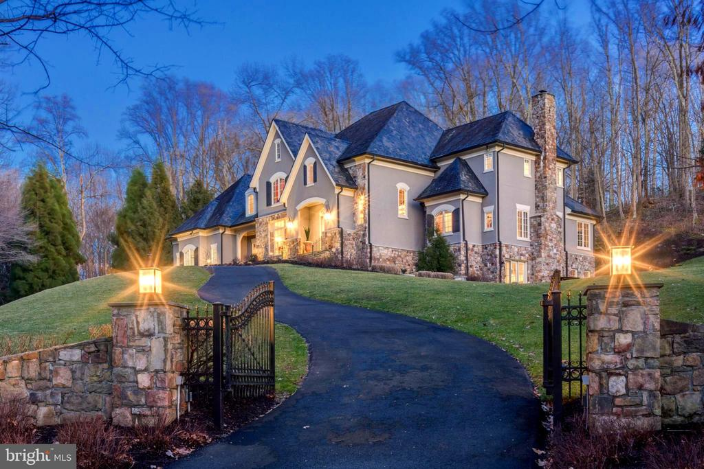 Absolutely exquisite custom colonial featuring over 8900 sf of timeless elegance with top of the line finishes and designer appointments throughout. This gated estate sits on two lushly landscaped acres including a circular drive and back loggia overlooking a spectacular waterfall feature. Special features include a dramatic two story Versailles style foyer,10 foot ceilings, expansive gourmet kitchen with adjoining great room with beamed ceiling and stone fireplace, cozy octagonal library with walls of windows and built-ins and lovely living room with a fireplace flanked by large windows. The floor plan offers a circular flow perfect for entertaining formally inside or informally outside under the covered porch.  The communication and family center off of the kitchen has a separate front entrance for family or could be used as a private office with separate entrance. The stunning owner's suite is complete with balcony, barrel vaulted ceiling, luxury modern Porcelanosa bath and custom designed walk-in closet with dressing area, special lighting, seated vanity with custom mirror and built-in wardrobe. The upper level includes three additional spacious en suites, all with walk in closets. A second stairway leads to the kitchen. The walkout lower level has an extraordinary amount of space including a kitchenette with bar, media/exercise room, wine closet, huge recreation room with gas fireplace and office that could be converted back to a bedroom. Prospect Hill is ideally located centrally to both Reagan and Dulles International Airport.  Just minutes to the Tysons Business District and the Toll Road to the Reston - Dulles Tech Corridor and to the new National Landing Amazon Headquarters.  The Village of Great Falls is just a short drive away. For outdoor enjoyment Great Falls National Park is just 2 miles down Old Dominion with hiking paths along the Potomac River with spectacular views of the Falls.
