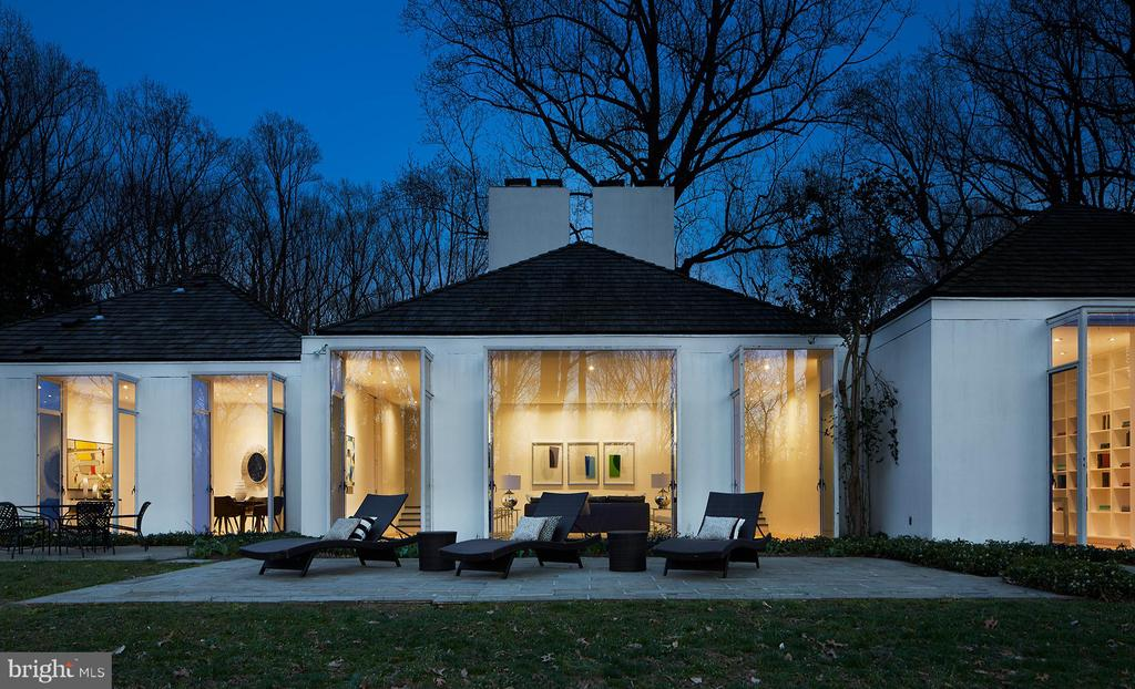 This sprawling private estate includes a total of 15 acres with a breathtaking modern home commanding the highest knoll. Designed by renowned architect Hugh Newell Jacobsen, FAIA., whose celebrated work is coveted by Washingtonians, this combined offering brings a tremendous opportunity to the McLean, Virginia market with a chance to own a home of architectural provenance on a rolling 10-acre parcel, and an additional 5-acre  parcel that encourages a new modern home, otherwise preserved for added bucolic seclusion. Sold together, or separately. The Jacobsen house with 10 acres offered for $4,800,000. The developable site with 5 acres offered for $1,750,000