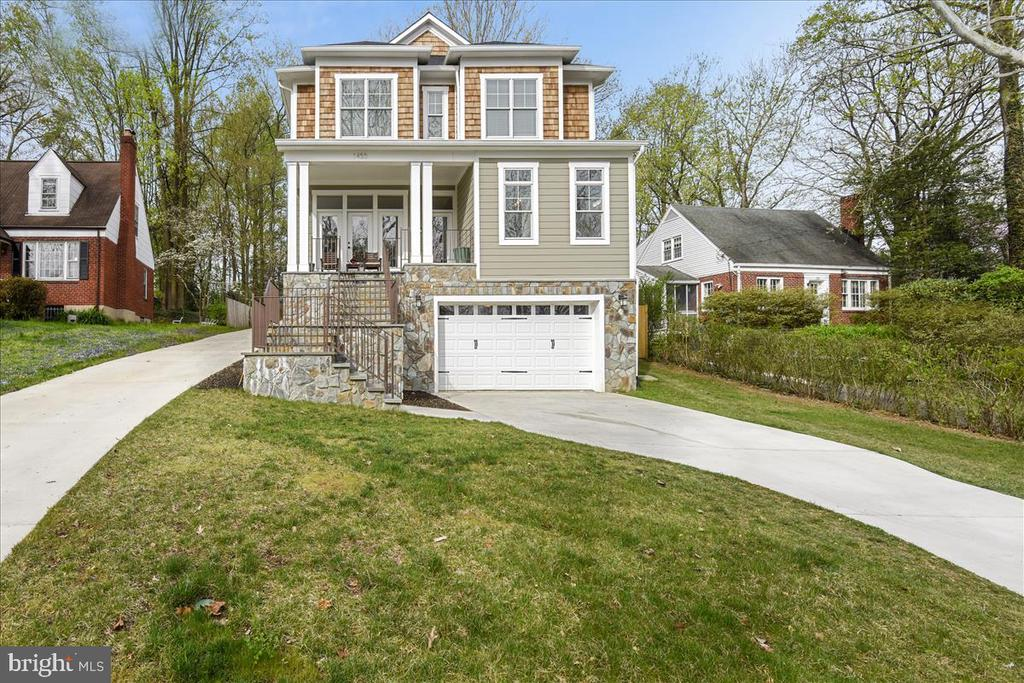 Located in a highly desirable prime walkable McLean neighborhood, this luxurious 6BR/5.2BA home is absolutely stunning. Get ready to fall in love with the gorgeous landscaping and beautiful exterior with flagstone front porch. Boasting over 5,000 square feet, there is so much room to enjoy. If you love to entertain, you just found THE ONE that will take your social game to a new level. Extraordinary finishes throughout and exquisite attention to precision detail can be found upon every turn. The open concept floor plan offers so many areas to gather and make awesome memories with family and friends. Enjoy a peaceful formal living room boasting loads of beautiful light flowing through the massive windows. The luxury infused kitchen features beautiful custom white shaker cabinetry, marble countertops/backsplash complimented with a gray shaker oversized island with White Quartz countertop, Thermador Regrigerator and GE Monogram appliances. Take your prepared gourmet dinners to the formal dining room adjacent to the kitchen and living room. There is a gorgeous family room with coffered ceilings, crown molding, and recessed lighting as well as a beautiful ledge stone accent wall and linear gas fireplace. This is the perfect place to mingle with guests as you can entertain up to 30 people between the family room and kitchen. There is a main floor guest bedroom  which is perfect for out of town guests, in-laws or potentially use as an office. The main floor bedroom also features a stunning full bathroom. As you make your way to the second floor, you will find three additional expansive guest bedrooms, all with large closets and custom bathrooms. The master bedroom is incredibly serene and the perfect place to unwind. Enjoy a quaint master reading area that overlooks the beautiful backyard and is the perfect place to curl up with a great book. The master features tray ceilings and an impressive dual master walk-in closets. The all marble resort caliber master bathroom offer