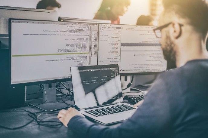 web developer writing code