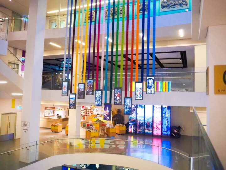Rainbow ribbons attached to screens showing Army videos hang in the central forum and can be seen from all floors at The National Army Museum.