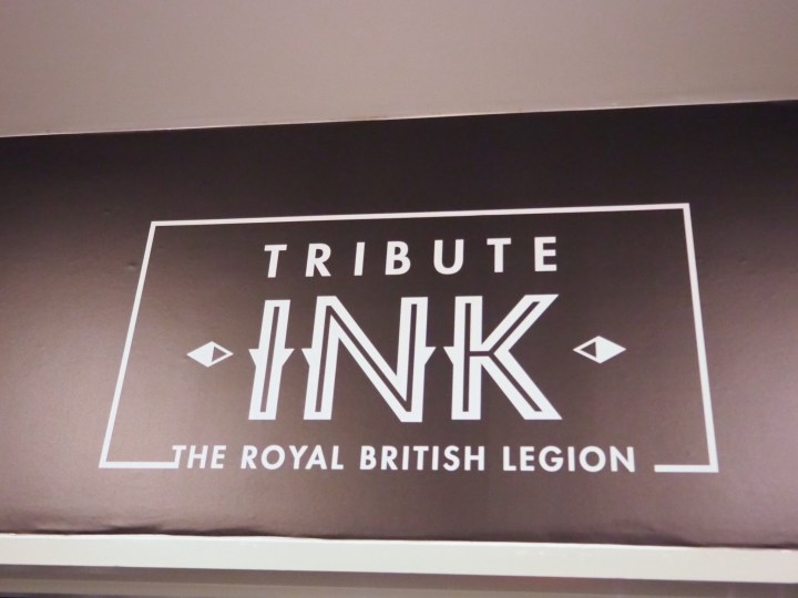 The black and white Tribute Ink logo and sign for the exhibition