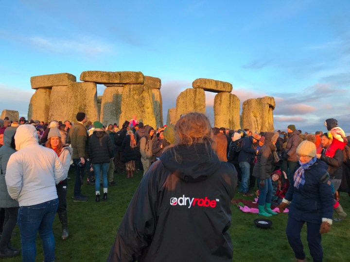 Bex from Bright Lights Big City wearing a long sleeve dryrobe at Stonehenge in Wiltshire, UK