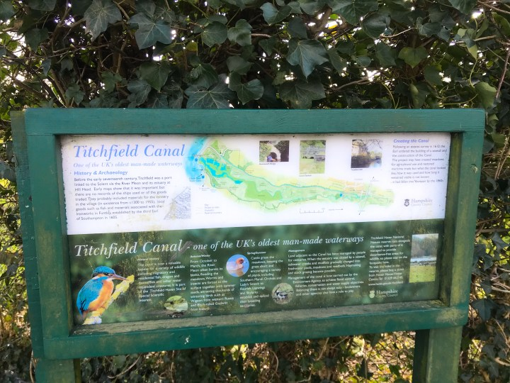 The sign for Titchfield Canal with a map and brief history of the area.