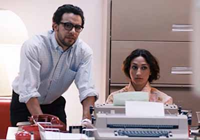 """We do see a woman at a typewriter being supervised by Bill Fernandez (Victor Rasuk), a recognizable low-level employee."""