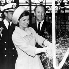 Jackie Kennedy christening a submarine