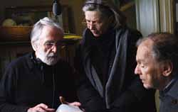 Michael Haneke (left) directing Riva and Trintignant and Emannuelle Riva in Amour