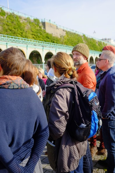 Building Green DIY Green Roof workshop crew hearing about the special green wall at Madeira Drive, Brighton