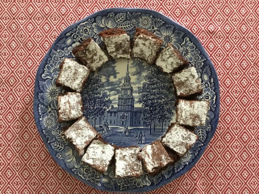 "A baker's dozen brownies on an old ""Liberty Blue"" plate."