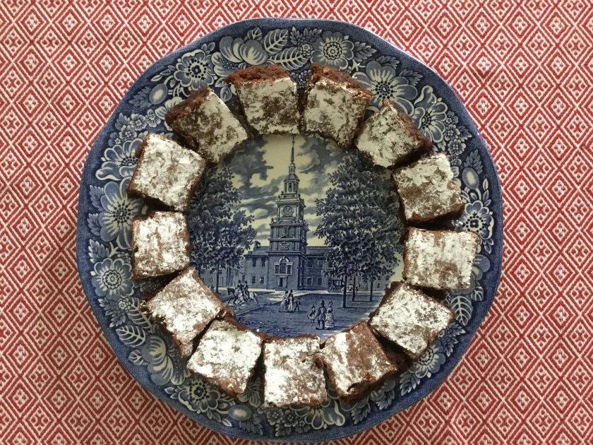 "A baker's dozen brownies on an old ""Liberty Blue"" plate."