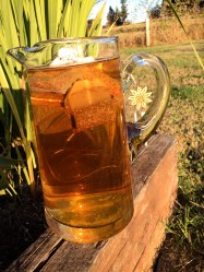 Set the pitcher in the sun (covered) for as long as it takes to become a rich dark amber.