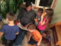 My uncle reading to his great-nieces and -nephews.