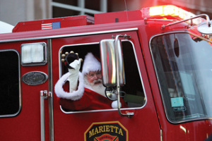 santa arrives in a fire truck in Marietta