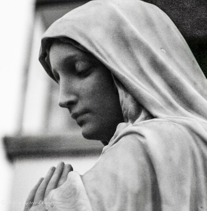 STREET PHOTOGRAPHY PICTURE BY BRIJESH KAPOOR OF MOTHER MARY IN BLACK AND WHITE