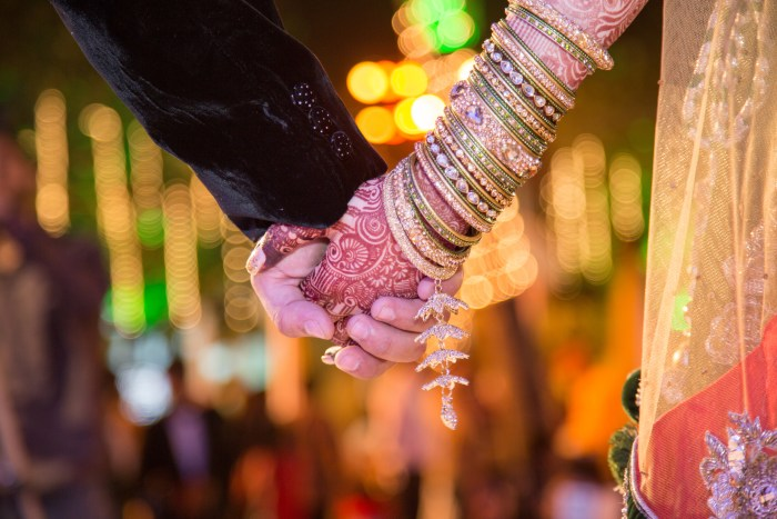 WEDDING PHOTOGRAPHY SHOT OF BRIDE AND GROOM HOLDING HANDS BY BRIJESH KAPOOR