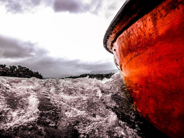 ORANGE BOAT IN THE OCEAN CLICKED BY BRIJESH KAPOOR DURING ONE OF HIS TRAVELS
