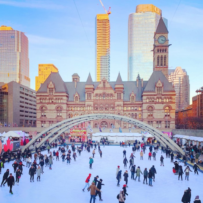 PEOPLE SKIING AT NATHAN PHILIPS SQUARE IN TORONTO CANADA IN JANUARY 2019 SHOT BY BRIJESH KAPOOR PHOTOGRAPHY