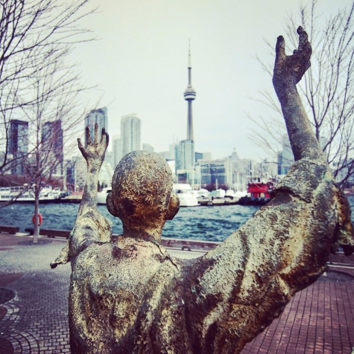 SHOT OF THE FAMOUS STATUE AT IRELAND PARK IN TORONTO CANADA LOOKING AT THE CN TOWER BY BRIJESH KAPOOR PHOTOGRAPHY