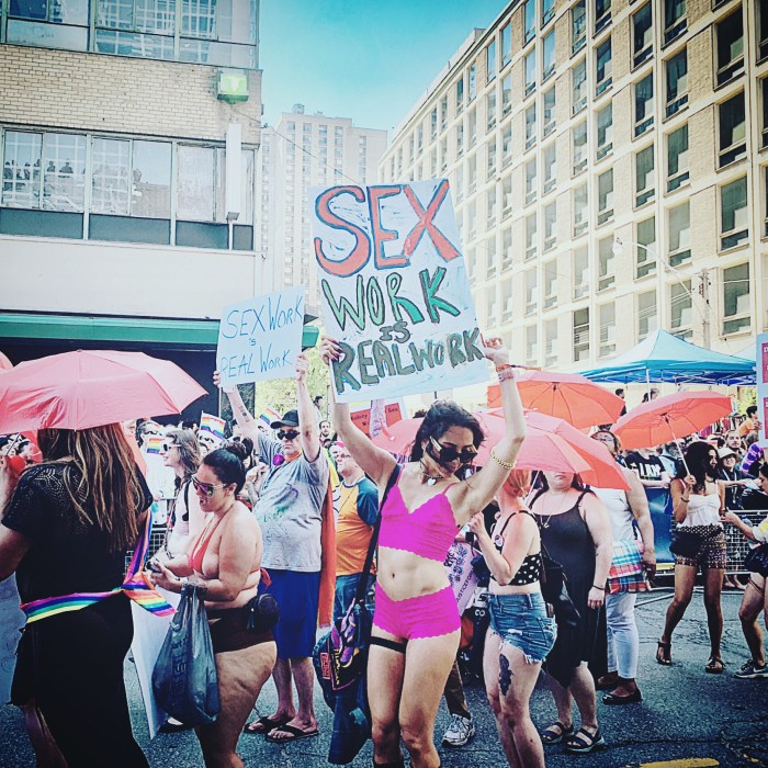 TORONTO PRIDE PARADE 2019 SHOT OF A SEX WORKER HOLDING A CARD BY BRIJESH KAPOOR PHOTOGRAPHY